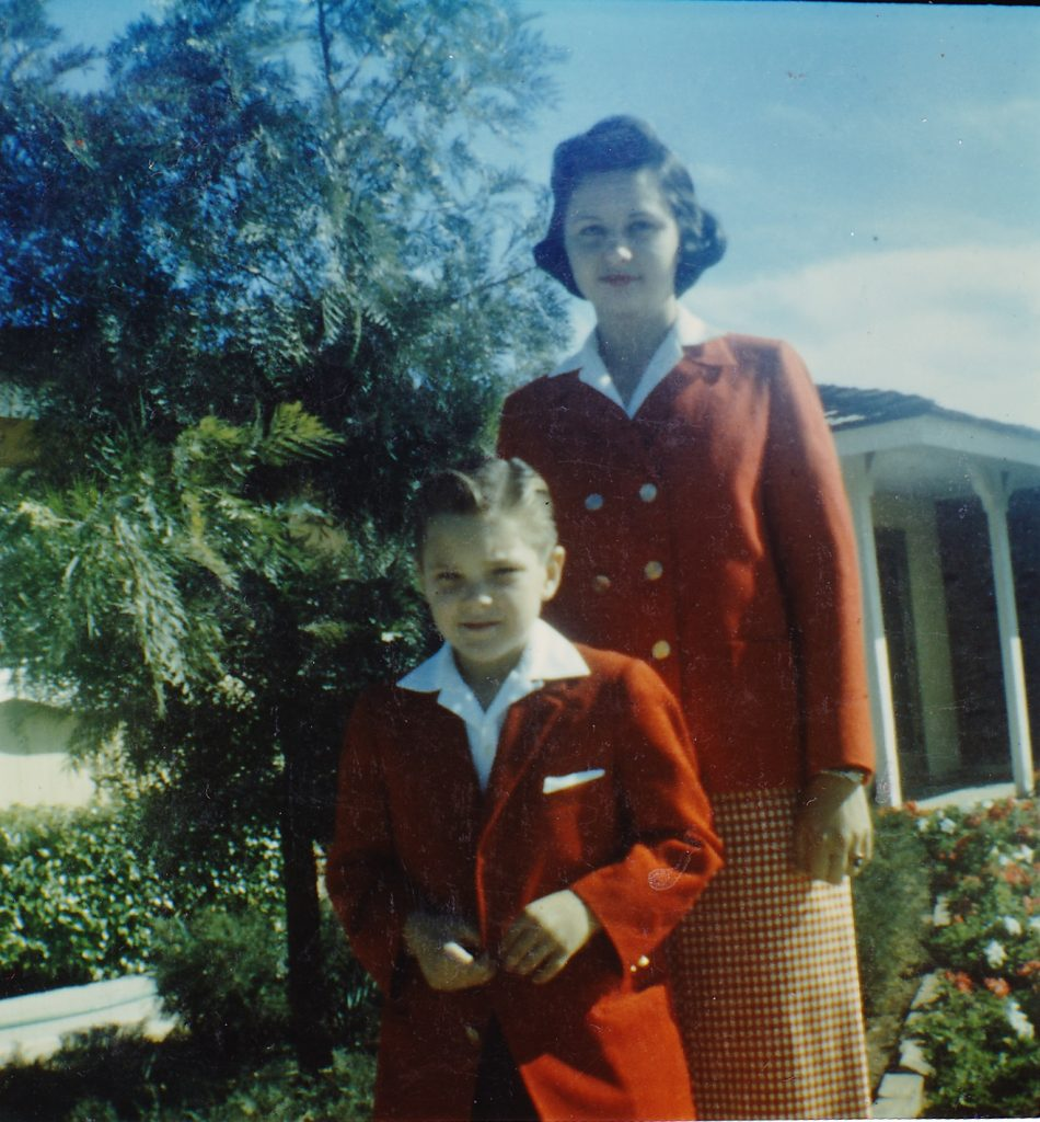 Siblings in matching red blazers for Easter