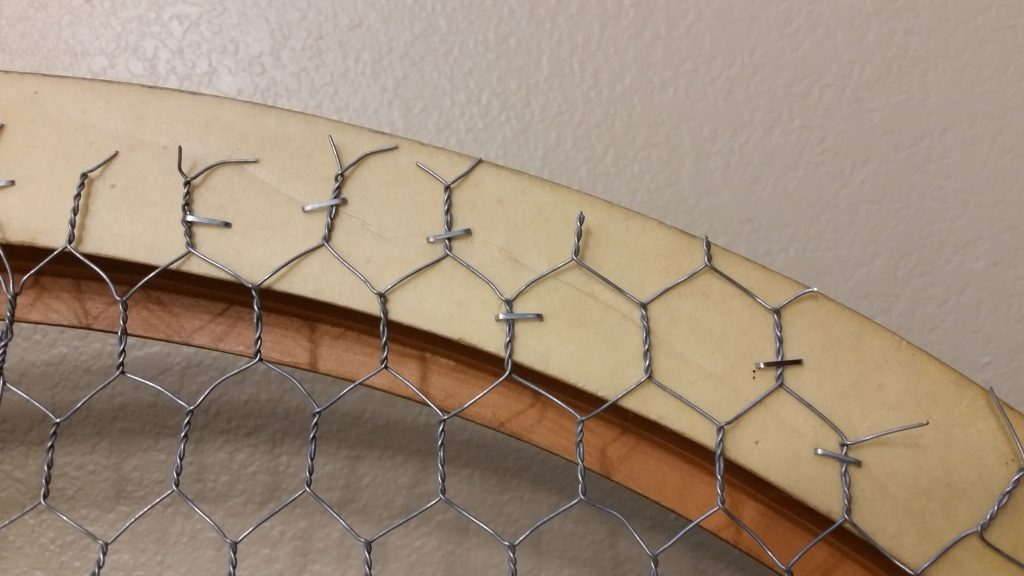 attaching chicken wire to a picture frame